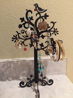 Sophia's Critiques: Dazone Birds Tree Jewelry Stand Display  Are you looking for a beautiful and organized way to store your jewelry?  The Dazone Tree & Bird display is so beautiful! Come check out my review :) #Dazone #JewelryStand #EarringStand #NecklaceStand #NoMoreTangeldNeckalces #Review #Fashion #BirdandTreeJewelryDisplay #Display #OntheBlog  http://www.sophiascritiques.com/2016/06/dazone-birds-tree-jewelry-stand-display.html