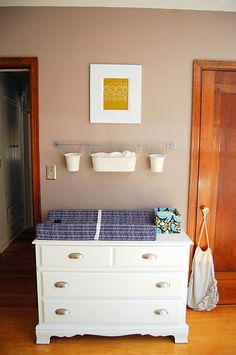 Cute Idea For Hanging Baskets Above The Changing Table.