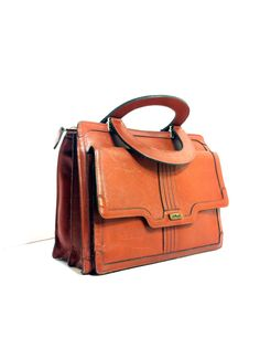 Hey, I found this really awesome Etsy listing at http://www.etsy.com/listing/151242996/70s-leather-handbag-satchel-mini-brief