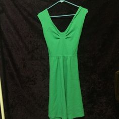 An Anthropology dress A cute green dress. The color is more like the first two pictures, just wanted to show you how the back has a cute little crisscross. Only have been worn once! Anthropologie Dresses Midi