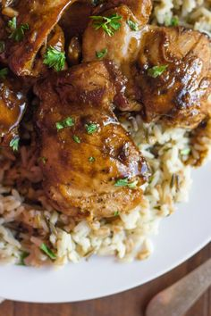 Creamy Balsamic Skillet Chicken - Rich, flavorful, boneless chicken thighs served over rice with a creamy balsamic sauce you'll love! #Recipe #Dinner #Chicken
