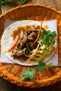 This recipe uses a mixture of hoisin and fish sauces as braising liquid, and is a riff on an old Corinne Trang recipe for wok-fried rib tips It results in a vaguely Vietnamese tangle of pulled pork that is best accompanied by a bright and crunchy slaw, and served on warm flour tortillas that recall the soft pliancy of Chinese bao Cooking time will vary depending on the slow cooker you're using, but generally the meat begins to fall apart nicely in the neighborhood of 5 to 7 hours