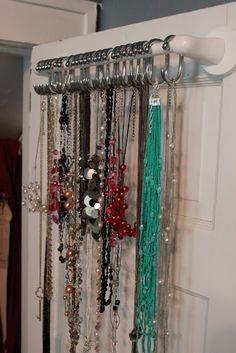 DIY necklace organizer...same concept but I like that it can go on the back of a door. Probably might do this one.