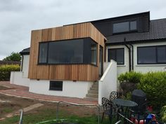 vertical western red cedar and white render on Milngavie extension design by Milngavie architects Extension Designs, Western Red Cedar, Restaurant Design, Glasgow, Architects, Shed, Outdoor Structures, House, Houses