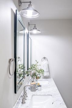 Classic gray bathroom featuring Benjamin Moore Classic Gray walls, designed by Scout & Nimble co-founder Jesse Bodine.