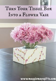 With so many cool tissue boxes out now, slide a small jar into one for a pretty flower vase