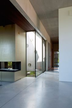 Brutalist-inspired residence by Clauwers & Simon is arranged around a central courtyard