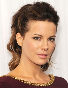 Kate Beckinsale's pony could have easily gone flat. Instead, she went with volume in the front and a sky high, wavy ponytail in the back. This (or a braid) is totally stylish yet will keep hair off of your neck and cool in the hotter weather. - GoodHousekeeping.com