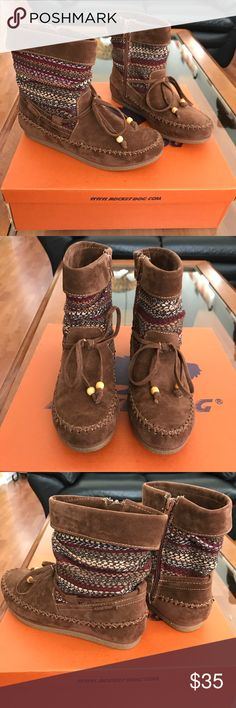 Rocket Dog Faux Suede Chestnut Short Boots SIZE 6. These are a pair of brand new in box Rocket Dog faux suede short boots in a fun chestnut brown and tan print. They are a moccasin style boot with zippers on the sides for easy on and off. These will ship in the original box with all original packaging. Rocket Dog Shoes Ankle Boots & Booties