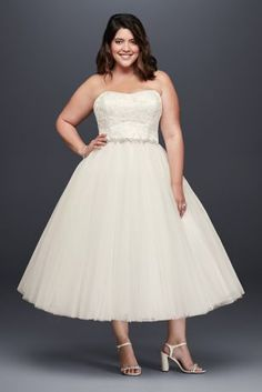 Shimmering with sequined appliques and adorned with layers of tulle, this tea-length wedding dress was made for the kind of celebration where you'll kick up your heels.   David's Bridal Collection  Polyester  Back zipper; fully lined  Dry clean  Imported  Also available in regular