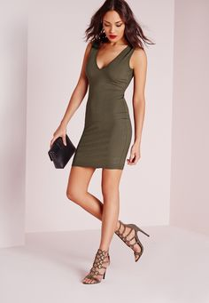Look Hot to Trot this season in a bodycon beaut from missguided. This smokin hot mini dress is one to watch right now. With figure flattering ribbed fabric this khaki number will ensure all eyes are on you this weekend. With sexy plunge nec...