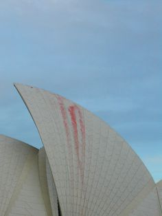 """""""Sydney Opera House. Someone had written 'No War' on the side of it the previous day, paint was just wearing off when i took this."""" by Flickr user Rick Farrell"""