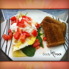 "BodyRock Meal of the Day: By Stephanie    ""Breakfast  Two eggs, one egg white, black pepper, handful of fresh spinach, one diced Roma tomato, a dollop of cottage cheese and a piece of whole wheat toast."""