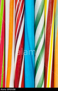 Multicoloured sticks of rock. Seaside rock pattern © Tim Gainey / Alamy