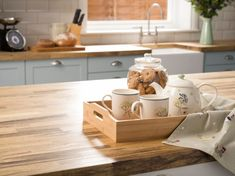 Give your kitchen a cosy makeover with the rustic trend's traditional wooden worktops, classic cream crockery, tempting cookie jars and farmhouse inspired accessories.
