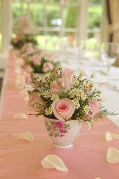 rose flowers in a teacup with blush runner
