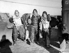 Members of the 381st Bomb Group, who participated in a successful raid over northwestern Germany, wear smiles and heavy flight clothes.