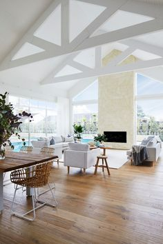 A lovely open plan space with crisp white edges! 🌿 __________________ Dappled with sunlight and anchored by vast expanses of white, this home is Hamptons in spirit but with a contemporary Australian-coastal treatment. Living Area, Living Room Decor, Brick Studio, Australian Homes, Australian Interior Design, Villa, Loft, Building Design, Decoration