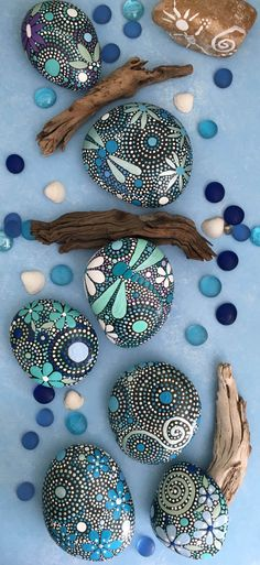 Hand Painted River Rocks from ethereal & earth - otherworldly & of this world creations - blue luminescence collections stones! Perfect natural art for the nature lover on your list. Rock Painting Patterns, Rock Painting Ideas Easy, Dot Art Painting, Rock Painting Designs, Pebble Painting, Pebble Art, Stone Painting, Art Patterns, Painted River Rocks