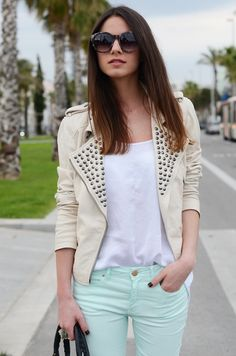Mint jeans, studded jacket and white shirt make a fashionable statement.#fashion