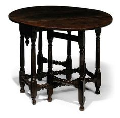 A QUEEN ANNE OAK GATELEG TABLE  EARLY 18TH CENTURY, WELSH.  With original finial to the frieze at one end, the other frieze plain, on turned legs and original feet.