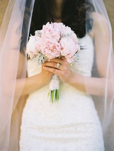 this is perfect in so many ways   1. Can't really see her dress, but i love what i see  2. PEONIES  3. That ring!  4. the veil!