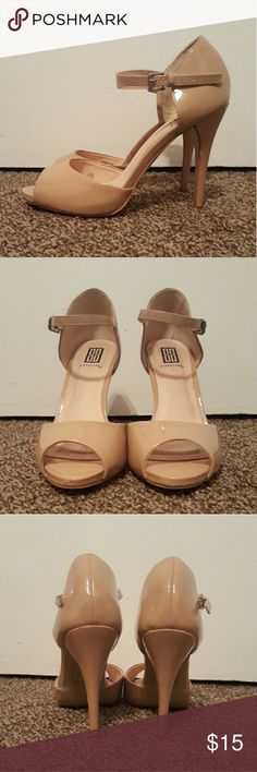 Nude heels Size 8. Only worn once at my prom years ago. Around a 4 inch heel. Shoes Heels