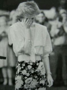 Stock Photo - CIRENCESTER - JUNE 30: Diana, Princess of Wales, wearing a blue flowered skirt and white blouse, attends a polo match at Cirencester Park on June 30, 1985 in Cirencester, England. (Photo by Anwar Hussein/Getty Image