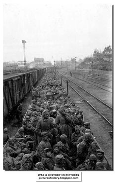 Russian POWs herded and transported like cattle on a train to a labour camp in Germany. More than three million Russian POWs died in German captivity.