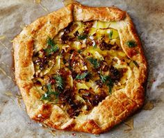 Goat Cheese, Leek and Potato Galette with Pistachio Crust. Galette : A type of flat, round cake from France. A pancake made with buckwheat flour, and often with a savoury filling, originally from Upper Brittany in France. | Creative Elegance Catering