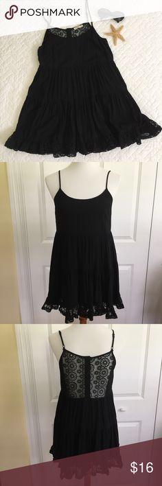"""Entro Black Tiered Lacy Tank Super cute - 100% rayon black fabric - fully lined - tiered tank - adjustable straps - floral lace back panel - lacy ruffle hem - tiny imperfection on neckline (see photo) - not really noticeable as the lining is also black - great pre-loved condition - approx measurements lying flat: length from top of bust to hem 26"""" armpit to armpit 17"""" Entro Tops Tank Tops"""
