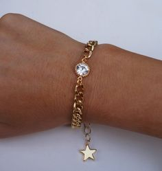 This beautiful, simple bracelet features: -a gorgeous, high-quality chunky gold curb chain -a sparking vintage crystal, framed in gold plate bracelet measures with a extender chain, and a shiny gold plated star charm on the end Thing 1, Simple Bracelets, Gold Plated Bracelets, White Enamel, Types Of Fashion Styles, Pearl Necklace, Fashion Jewelry, Chain, Crystals