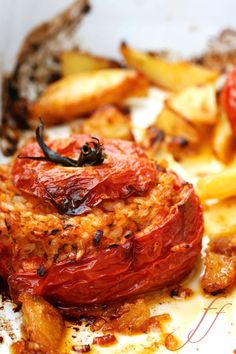Oven baked tomatoes stuffed with spiced rice and roasted potatoes.  One of my favourite dishes of all!
