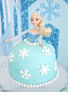 Learn to make this EASY Elsa doll cake for a Frozen birthday party!