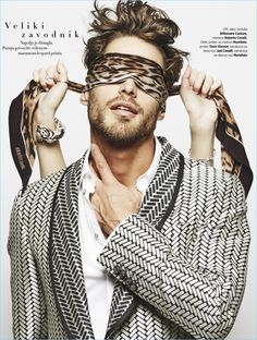 Model Simone Bredariol wears a leopard print Roberto Cavalli scarf and a graphic dinner jacket by Billionaire Couture.