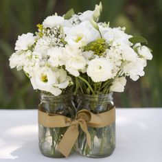 Three mason jar centerpiece... could use cheaper fresh flowers (white) and then blue bows to represent their colors! <3 <3 Also, could do this same arrangement with only one jar! <3