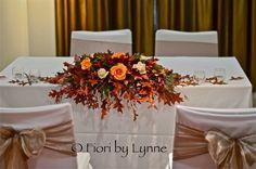 Image from http://2.bp.blogspot.com/-tL2pdnGB870/UqIkRpzuBuI/AAAAAAAAEYE/zaVmSrnLxbQ/s1600/ceremonyTable-flowers-autumnLeaves%252Crose%252Cberry-twig.jpg.