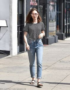 Cool girl: For her coffee, the daughter of Phil Collins looked effortlessly stylish...