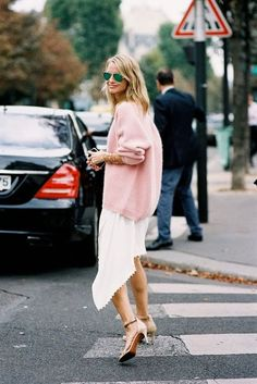 Holli Rogers in a fab pastel pink sweater and asymmetrical skirt situation.