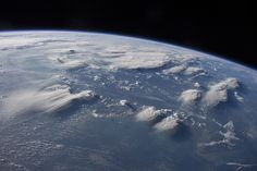 Crews aboard the International Space Station (ISS) have recently focused their cameras on panoramic views of clouds. Many of the photographs have been taken with lenses similar to the focal length of the human eye. Such images help us see Earth the way ISS crews see it from their perch 350 kilometers above—with a strong three-dimensional sense and a broad view of the planet.