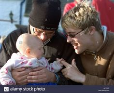 a gay couple holding a six month old baby Stock Photo, Royalty Free Image: 2457659 - Alamy