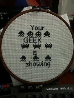 geek is showing - space invaders cross stitch