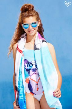 Show your sense of your humor in our puppy graphic swimsuit and towel. Real-life doggie lifeguard not included.