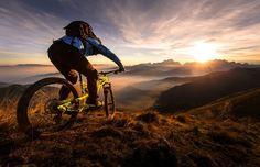 mountain biking into the sunset