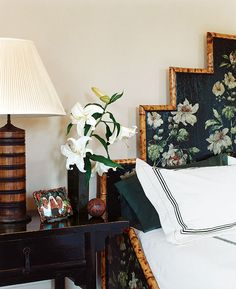 A whiff of exotica emanates from this Asian-inspired master bedroom in a Hamptons home, reflecting both the owner's fascination with the Far East and and her youthful edginess. As the largest furnishing and a natural focal point, the lacquered decoupage-and-bamboo stair-step shaped bed boldly declares the exotic theme. The bedside table is a Chinese antique.