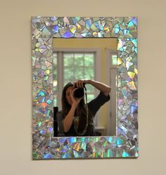 diy. Mirror decorated withcut pieces of CDs