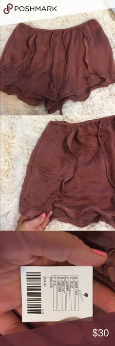 High waisted silk shorts URBAN OUTFITTERS SIZE LARGE SILK SHORTS! Never been worn and even has the tags on. Super cute Maeve or dusty pink color and frilly hem. Tulip shaped yet the sides do not open up and expose your leg. Love these, just too big for me Urban Outfitters Shorts