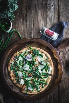 A delicious and easy recipe for a spring produce pizza with a creamy white chevre, ricotta, and Greek yogurt sauce from the First We Eat cookbook. Easy Family Meals, Easy Meals, Family Recipes, Quiche, Greek Yogurt Sauce, Baking Stone, Vegetarian Recipes, Pizza Recipes, Dinner Recipes