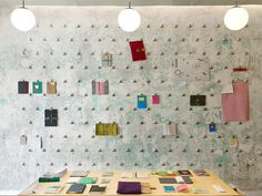 wall of binder clips / Papelote Stationery Shop by A1Architects