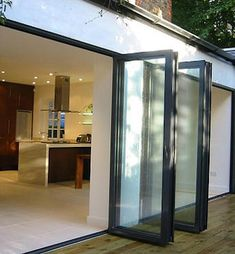 Glass accordian doors. I love this concept. Opens the inside to the outside